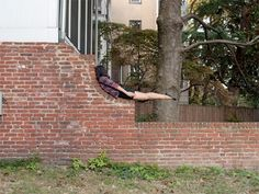 For her project titled Learning to Love the State I Am In, photographer Sam Schubert takes planking to a new level by putting her body in bizarre positions and locations in order to & herself into the materials and environments found in Baltimore. Miranda July, The Next Big Thing, Environmental Design, Contemporary Photography, Learn To Love, Planking, Landscape, Outdoor Decor, Nature