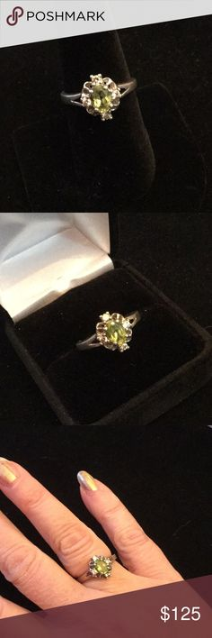 Genuine Vintage Peridot & White Topaz Ring This is just so exquisite in its dainty romantic design.  A genuine Peridot surrounded by tiny white Topaz set off this heirloom Edwardian styling.  A perfect addition for your heirloom jewelry collection.  Set in .925 silver this ring would be pricy in a jewelry store Estate Sale Jewelry Rings