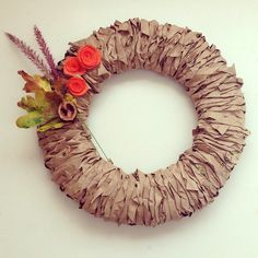 Fall wreath made from...ready? PAPER BAGS!! Good way to recycle the bags from the store! And it's just stinkin' cute.
