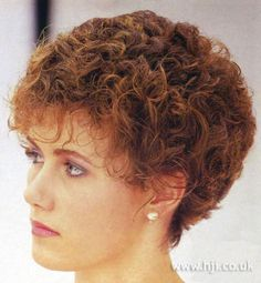 1984 short curl hairstyle. Red curly hair was cut into short layers and