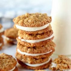 Carrot Cake Cookies - Tender oatmeal cookies filled with cinnamon, grated carrots and coconut, filled with cream cheese frosting. Fall Desserts, Cookie Desserts, Cookie Recipes, Cream Cheese Cookies, Cream Cheese Frosting, Carrot Cake Sandwich Cookies, Carrot Cookies, Fall Cookies, Christmas Cookies