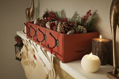 DIY Stocking Holder made from simple cedar box & a few coat hooks, looks beautiful placed on fireplace mantle. Rustic Christmas Mantel