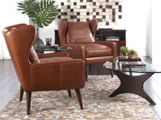 Scandinavian Designs - The Giesen is big, luxurious comfort at a great value. Inspired by mid century design,  features a high wing back with deep seating and tapered wood legs in a walnut finish. You'll love the comfort. Available in a medium walnut brown leather.