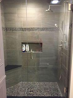 Large charcoal black pebble tile border shower accent. https://www.pebbletileshop.com/gallery/Charcoal-Black-Pebble-Tile-Border-Shower-Accent.html#.VVOCPCFViko
