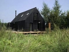 Volga Dacha House in Russia. Vertical black t&g, black frames, black roof