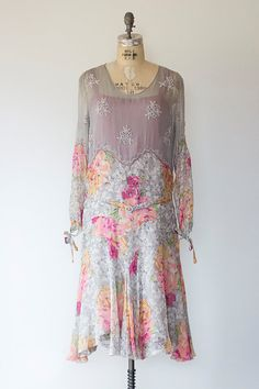 Perfect for a garden party,afternoon tea or summer wedding. The dress has lovely beaded flower motifs scattered through the bodice and sleeves. It is