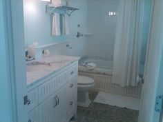 One of my favorite bathrooms with sea glass tones and heated tile floors. Cottage at Castle Hill Inn, Newport RI