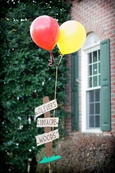 Winnie the Pooh Party- cake with honey dripping, 100 acre woods sign, quotes from books