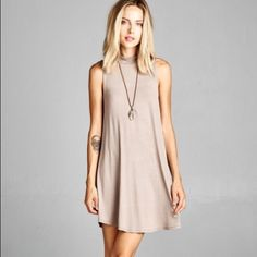 Mocha Basic Sleeveless Tunic Dress A staple for every wardrobe this season! Can't get enough of them! Color: Mocha (neutral color is great!) Solid, sleeveless tunic dress featuring an A-line silhouette & reverse stitching on back panel. Unlined-Non-sheer. Lightweight. 95% Rayon, 5% Spandex. **Available in Small, Medium, & Large** Please do not purchase this listing; simply comment the size you'd like & I'll make your own listing. Dresses Midi