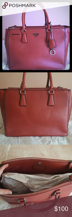 Gorgeous Red Inspired Tote Beautiful inspired Prada tote!!!  I've had this for years and never got around to using it.  Perfect large size to hold a lot.  Durable bag!!!!  Offers welcome! Bags Totes