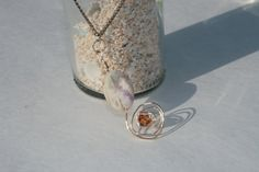 Hand wire wrapped stone and crystal necklace.   BRITTLESSHIP.ETSY.COM