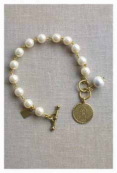 Our classic mini coin initial, now on a delicate pearl bracelet! Great for a lig… - Pearl Jewelry Custom Jewelry, Diy Jewelry, Beaded Jewelry, Jewelry Accessories, Handmade Jewelry, Jewelry Design, Fashion Jewelry, Jewelry Making, Jewelry Ideas