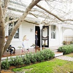 The classic white exterior of Claire's Victorian cottage is complemented by neat hedging and a beautifully finished timber porch. As featured in the December 2014 issue of homes+. Cottage Exterior, House Paint Exterior, Lush Garden, Home And Garden, Black Screen Door, Weatherboard House, Queenslander, Victorian Cottage, Australian Homes