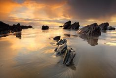 Sunset after a stormy day on the South Coast of Cornwall, England.