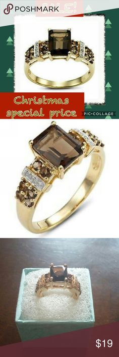 18CT yellow gold filled brown tanzanite ring. 18CT yellow gold filled brown tanzanite ring.  Main stone size 10x8mm, Main stone weight 6CT.  Around stone CZ, Size 3x3mm and 2x2mm. Size 7 band. Jewelry Rings