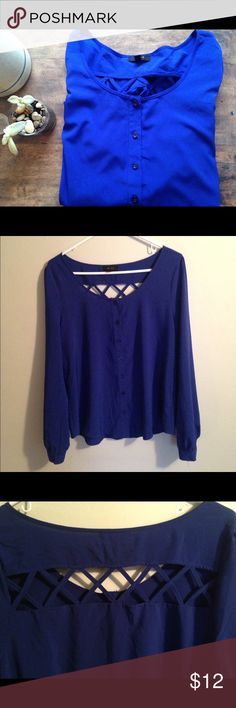 Royal Blue Blouse Royal blue blouse with lattice detail on back. Stretchy material--can be dressed up or down! Tops