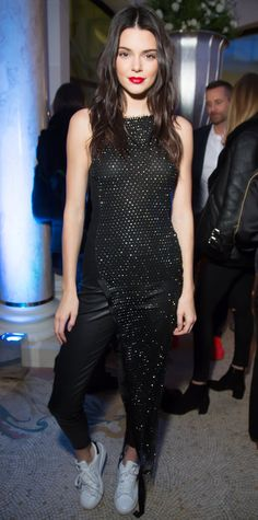 Kendall Jenner in a shimmery asymmetric black dress.