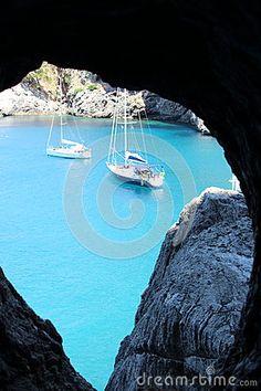 View from an tunnel window over the Cala de sa Calobra crick and boats. Majorca, Spain