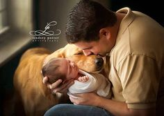This man was having a portrait photo taken with his baby, However the dog didn't want to miss out so joined the love