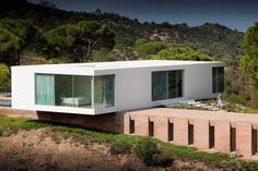 House in Melides by Pedro Reis  White, glass and compressed earth, nice and simple, great balance.