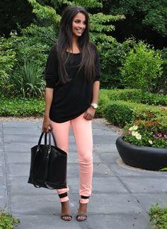 Colorful pants black shirt contrast.