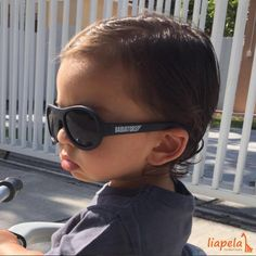 Nico cruising on his tricycle wearing his very cool sunglasses  but more importantly he's protecting his eyes from the strong South Florida sun. Find these sunglasses in many different colors at Liapela.com USD$20 Like on Instagram @LiapelaModernBaby