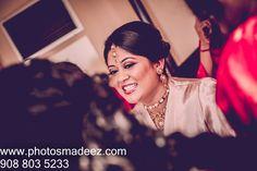 Bride Getting Ready Photo at Mahwah Sheraton - Indian Wedding. Best Wedding Photographer PhotosMadeEz, Award winning photographer Mou Mukherjee. Along with Design House. Featured in Maharani Weddings.