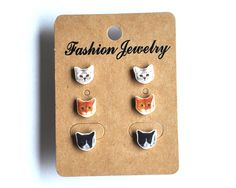 To wear them all at once or to combine. Set of 3 sweet pairs of cat studs. Handmade by Barking King  http://www.alittlemarket.com/autres-bijoux/fr_lot_boucles_d_oreilles_puces_chats_3_kawaii_paires_de_clous_d_oreilles_pour_oreilles_percees_-12780459.html