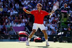 Roger Federer of Switzerland celebrates his 4-6, 7-6, 19-17 win over Juan Martin Del Potro of Argentina in the Semifinal of Men's Singles Tennis on Day 7 of the London 2012 Olympic Games at Wimbledon on August 3, 2012 in London, England. (Photo by Clive Brunskill/Getty Images)