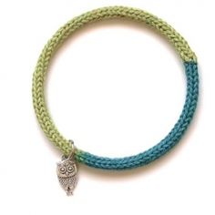 Create this quick and funky bangle using knitted icord and a small charm.