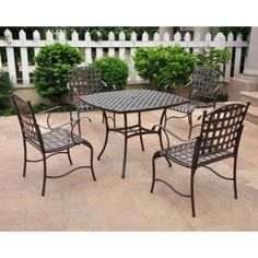 Santa Fe Wrought Iron Patio Dining Set - Seats 4 by Intl. Caravan. $425.25. Set includes a table and 4 chairs. All pieces feature classic basket weave pattern. Square shaped table has a hole in the middle for an umbrella. Constructed of sturdy, durable metal. Some assembly required. The Santa Fe Wrought Iron Patio Dining Set - Seats 4 brings some Southwest flavor to your outdoor living space with a classic basket-weave pattern. The square table and four chairs are co...