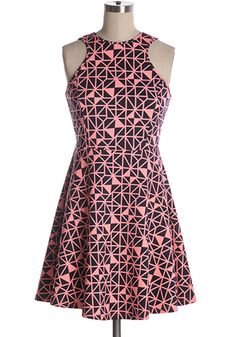 Black and pink geometrically printed dress with a-line skirt and racerback neckline. BAck zipper. 75% cotton, 25% rayon Slightly stretchy Not lined Indie, Retro, Party, Vintage, Plus Size, Convertible, Cocktail Dresses in Canada Origami Lesson Dress -