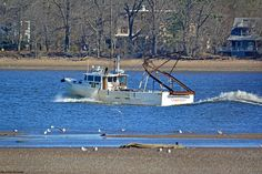 Here's Charisma, passing the Pennypack Creek Sandbar at low tide. Just noticed the boat comes out of Cape May, NJ.