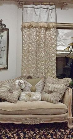 Luxury Window Treatments and Accent Pillows in rich cream tones of embroidered silks, faux fur, chenilles and soft textured fabrics, embellished with feathers, beads, and Swavorski crystal pieces.