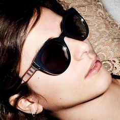 Bella in runway lace and check-accented sunglasses. Shot by Mario Testino