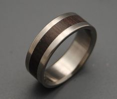 Wooden Inlay! (Cocobolo Heartwood needs little more than a simple satin touch in this titanium band.)