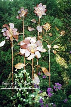 Copper Flowers - using plumbing supplies (copper tubing & copper flashing) you can cut out and solder your own metal garden sculptures