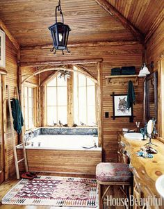 This bathroom designed by Mimi Maddock McMakin of Kemble Interiors is covered with pine beadboard, giving it a rustic look.