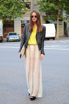 leather jacket, clutch, nude palazzo pants, with a pop of yellow
