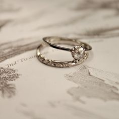 Simple and delicate so pretty I love it!!! It's so gorgeous! love the pretty wedding band too