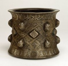 Mortar. Made of engraved and silver inlaid bronze, copper.