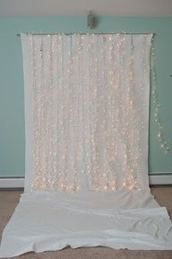 super easy diy backdrop for baby/newborn/toddler photography - hang up a nice sheet and string some lights