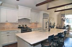 Kitchen with white cabinets and travertine countertops and backsplash White Kitchen Cabinets, Kitchen And Bath, New Kitchen, Travertine Countertops, Kitchen Countertops, Diy Kitchen Remodel, Traditional Kitchen, Conception, Modern