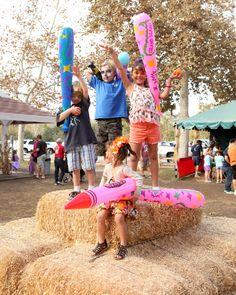 Showing off prizes won during the carnival games -- all children win a prize! Irvine Park Railroad Pumpkin Patch -- www.IrvineParkRailroad.com #irvineparkrailroad #orangecounty #pumpkinpatch #trainrides #pumpkins #ocparks