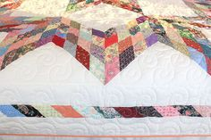 Quilts on sale through Midnight 12/2 Discounts already taken  Very gorgeously pieced quilt in a broken star pattern. Multicolored cotton fabric prints on a white background. Hand-picked fabrics, machine pieced and quilted. Border detail is nicely pieced with diagonal pattern. A bit of modern style on this traditional quilt, surely to grace any room it is in! Reverse side is solid white.  Dimensions: King - 96 x 102 inches (Will fit queen with longer drop on sides)  Material: 100% cotton,...
