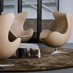 Fritz Hansen Egg Chairs in Natural Leather in Lobby with Natural Wood Coffee Table