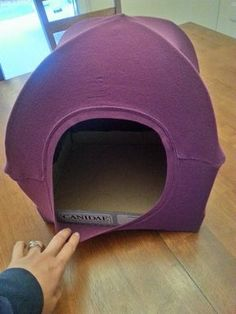 cat tent with t-shirt 2 wire hangers and the card board case from canned cat food