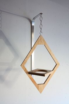 Back to the Future: A Style Wooden Hanging Planter Made to order from clear coated maple plywood, the Jungalow Hanging Planter hangs from a metal chain and comes with a metal mounting arm. Wooden Planters, Hanging Planters, Diy Wood Projects, Wood Crafts, Diy Plant Stand, Plant Stands, House Plants Decor, Diy Holz, Plant Holders