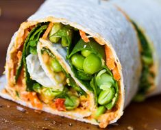 Healthy Gut Veggie Wraps. Use whole wheat or gluten free wraps, add some Hummus, Spinach, Edamame, Avocado and other fresh vegetables and eat for a great light dinner or pack them for easy snacks.