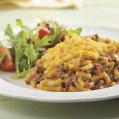 Beef Mac & Cheese 1 pkg. (7-1/4 oz.) KRAFT Macaroni & Cheese Dinner 1 lb. lean ground beef 1 can (14-1/2 oz.) Italian-style stewed tomatoes, undrained 1/2 tsp. dried oregano leaves 1/2 cup KRAFT Shredded Cheddar Cheese Make It Heat oven to 400ºF. Prepare Dinner as directed on package, omitting the butter. Meanwhile, brown meat in large nonstick skillet on medium-high heat; drain. Add tomatoes and oregano; mix well. Bring to boil.  Add meat mixture to Dinner; spoon into 9-inch square baking…